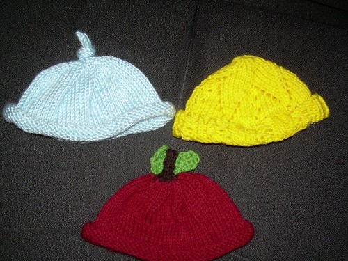 a trio of baby hats
