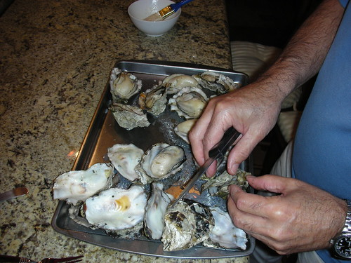 Dad opening his BBQ'd B-Day oysters