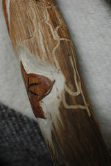 Detail of natural ant tunnels and carving on handle of plaited broom