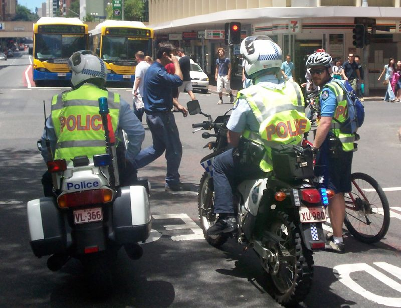 Two Wheeled police at the corner of Adelaide St and Edward St - Justice for Mulrunji Rally at Queens Park and March through Brisbane City, Australia, November 18 2006