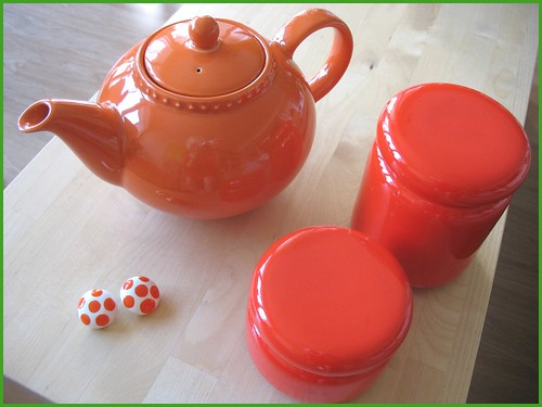 my new tea pot!  and (some) thrifted orange things.