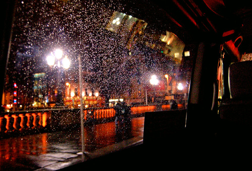 Rainy O'Connell Bridge from the back of a taxi