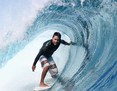 Pro-surfer Dennis Tihara surfing a tube at Teahupoo, Tahiti. photo by cookiesound