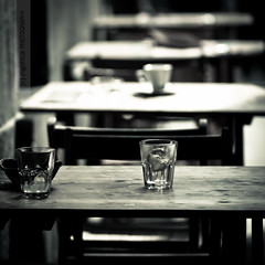 empty [glasses, cup, tables, seats] photo by sergi meseguer
