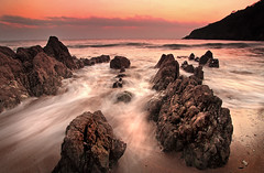 Mothecombe rocks at sunset photo by jezm2000