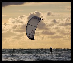 Kite surfer at sunset photo by Levels Nature