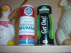 A ceramic goose, tinned malt extract, gherkin tin