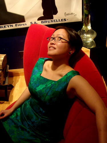 Portrait of Steph on the Red Settee