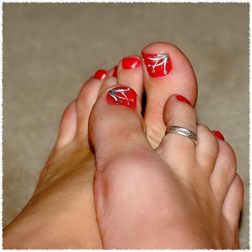 toe ring tattoos