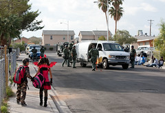 Police Raid, Children Walking photo by metroblossom