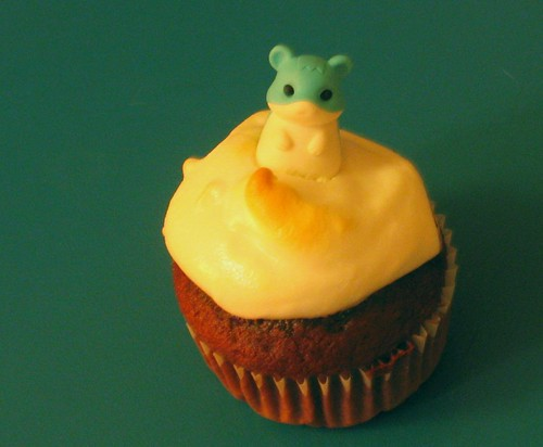 chocolate cupcake with meringue and hamster