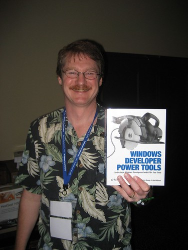 Jim Holmes holding his new book