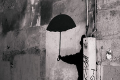 man with dark umbrella photo by Camil Tulcan