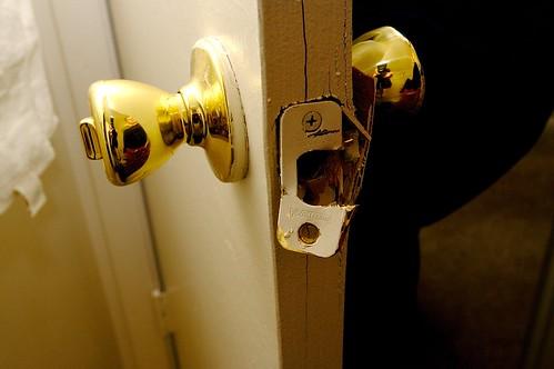 Busted bathroom door (again)