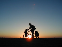 Sunset cycling in Sudan photo by www.AlastairHumphreys.com