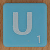 Scrabble white letter on pale blue U