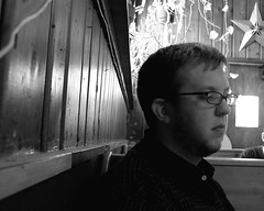 Photo of Galen at breakfast at the Seward Cafe, eyes almost closed