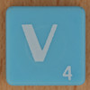 Scrabble white letter on pale blue V