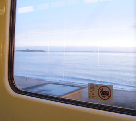 View from the DART- feet on seats sign