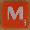 Scrabble white letter on orange M