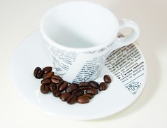 Espresso Cup & Coffee Beans photo by Stian Kildal