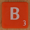 Scrabble white letter on orange B