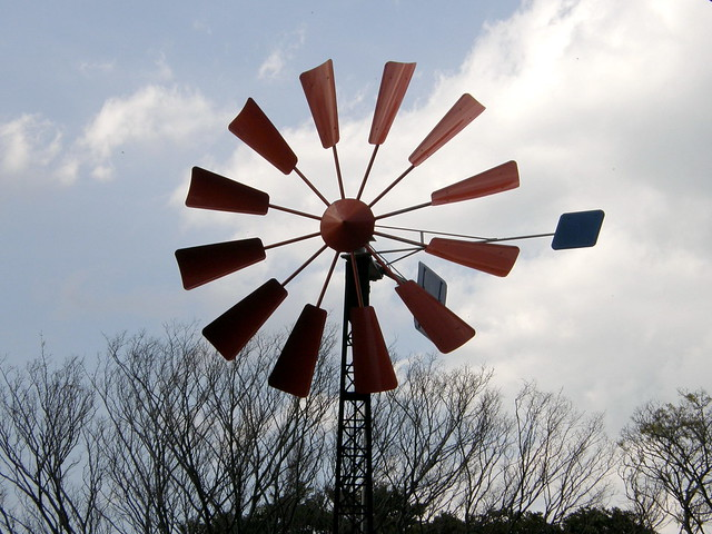 A windpump is a windmill used for pumping water, either as a source of fresh water from wells, or for draining low-lying areas of land. Once a common fixture on farms
