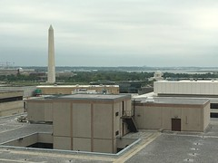 The sublime and the hideous: monuments and Potomac with office building roof, Washington, D.C.