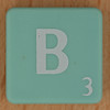 Scrabble white letter on pale green B