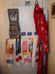 behind bathroom door, towel organization