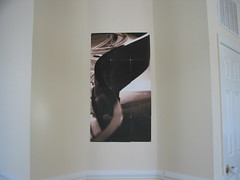 piano picture hung in entry