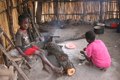 Lizazi Village, a sister makes breakfast for her brother.