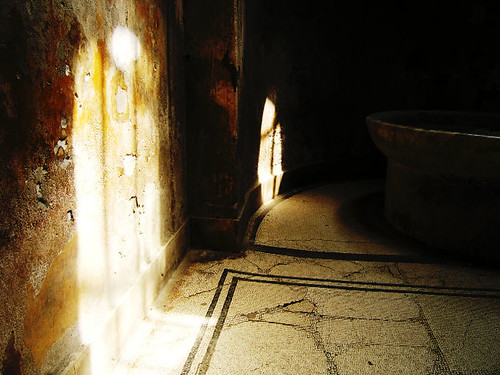 Standing inside a broken Pompeiian bath with camera in my hand.
