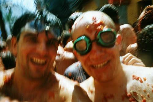 Revelers covered in tomatos at Tomatina Festival.