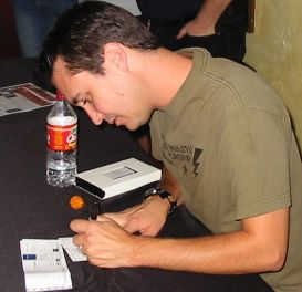 Wil Wheaton signing a card for the woman in front of me