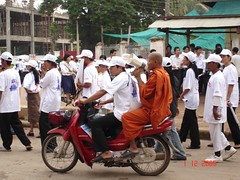 monks doing advocacy and education work in action