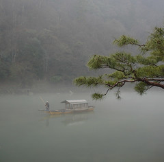 Old man boating down river (Japan) photo by Eoghan Lynch