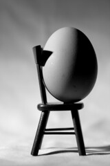 Chair and Egg photo by Moochin Photoman
