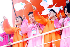 North Korean cheerleaders leave Busan Harbor about the Mangyeonbong-92 in 2002, to the cheers of hundreds of handpicked South Korean supporters