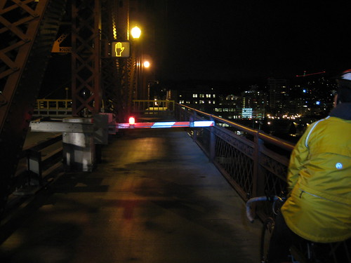 Gate prevents crossing Broadway Bridge as ship passes under