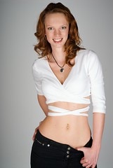Portrait of a young redhead caucasian woman wearing a white crop top photo by HuntsmanPhoto