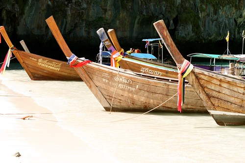 longtail boats in Maya Bay (by mintyfreshflavor)