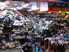 Mountain of shoes in Japan photo by Eoghan Lynch