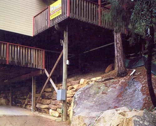 Pole house on rock