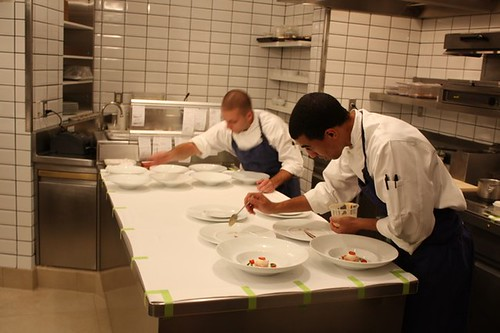 Meticulous preparation comes to a close for each dish here before being whisked away by the servers