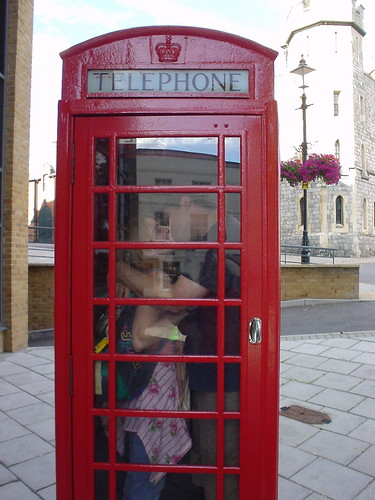 Making out in red phonebooth in England