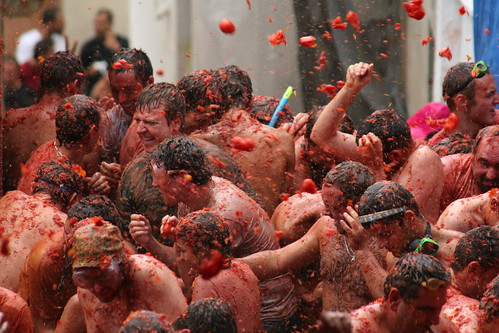 Tomatoes in the air at Tomatina Festival.
