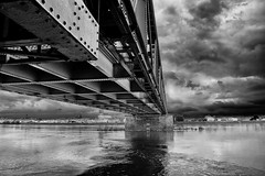 Bridge under troubled skies photo by pattoise