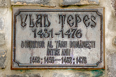 Plaque under statue of Vlad Tepes photo by Curious Expeditions