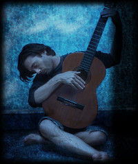 the old guitar player (photo reinterpretation of picasso) photo by Jason O'Donnell